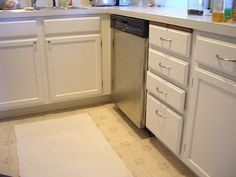 Her kitchen looks Great! I used the Rustoleum Cabinet Transformations on my bathroom vanity in pure white and it looks fantastic! I was too chicken to try it in the kitchen first, just in case it was a disaster! I am taking all the new hinges I purchased back and spray painting the old ones.