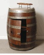 It's a barrel of fun, storage, and possibilities. The Full Barrel Cabinet on Casters serves multiple purposes. Made from a reclaimed oak wine. Barris, Shelf Nightstand, Wine Barrel Furniture, Acorn And Oak, Wine Decor, Cottage Style Homes, Pirate Theme, French Oak, Country Furniture