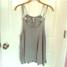Grey Crochet Lace Back Tank Top Stunning light grey tank top. Size large, but meant to be loose and flowy, so could fit a size XL. Crochet detail down the back. Great condition. Feel free to make an offer or bundle! ✨ Others Follow Tops Tank Tops