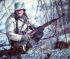A Waffen-SS winter trooper wields a then recently commissioned Walther Gewehr-43 gas-operated, semi-automatic rifle as he takes position during the frigid winter on the Eastern Front. Soviet Union, January 1943.