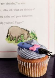 Grape soda cupcakes with blueberry cream cheese frosting and Eeyore tails!