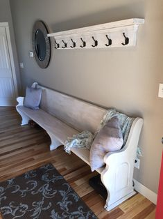 Refinished church pew with custom coat rack to match. Perfect for a long entryway.