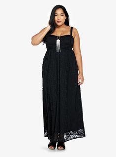 Tonal chiffon stripe insets lend textural contrast to this flowy black lace maxi dress. A smocked back and an empire waist give it an effortless, flattering shape.
