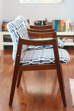 mid-century redesign - i have a chair like this with green manogahide that is in desperate need of a revamp... but again - I lvoe the clean lines of mid century design. It's going to make an awesome accent chair in the living room