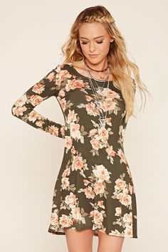 A soft knit skater dress featuring an allover floral print, long sleeves, and a round neckline.