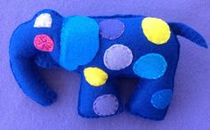 Elephant plush baby rattle by Ecotrinkets - Amy Monthei.           https://www.etsy.com/shop/Ecotrinkets?ref=search_shop_redirect
