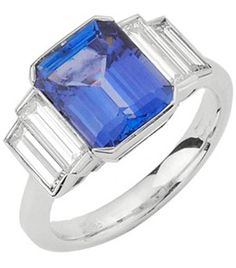 18ct White Gold Sapphire and Diamond Ring. Emerald cut sapphire centre stone, end set, stepping down to 2 rubover set baguette diamonds on either side to form shoulders.   Can also be made in platinum or yellow gold.
