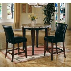 Steve Silver Montibello Pub Dining Room . . . I actually own this set (mine has 4 chairs tho , got it at Aarons for $678.95) . .  very heavy and solid