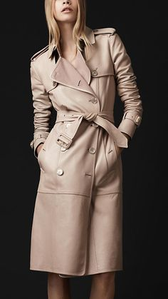 Sensual trench coat crafted from an understated tanned leather  Bonded leather panels accentuate the structure  Distinctive luggage stitching  Classic heritage epaulettes, gun flaps, belted waist and cuffs  Back rain shield, central back vent  Hook and eye collar, buttoned pockets  Subtle nude leather buckles  Distinctive pearl buttons engraved with the Burberry Prorsum logo