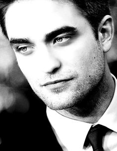 Robert Pattinson…his eyes are my favorite feature on his face <3