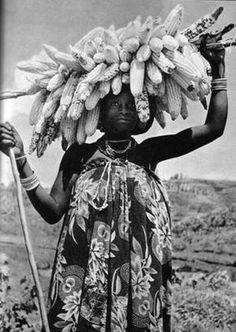 Africa | Hutu woman carrying her corn crop. Rwanda. 1958 | ©P. Laval, Congo Presse