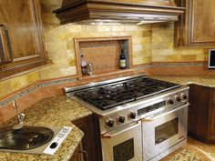 love the ledge behind the stove to put those commonly used oils and spices!    BEAUTIFULLY TILED TRADITIONAL KITCHEN