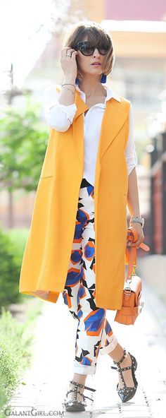 Boyishly tossled hair, crisp shirt, skinny jeans with playful print, boxy vest and rectangular, structured bag, angular shoes.