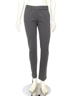 Stylish slim fitted, straight leg ponte knit pants from Theory! These pants are made out of a heavy weight stretch knit material and come in a versatile medium gray color. Styling includes a low rise with zip fly and extended tab hook closure, slant pockets at the hips, pintucked seaming down the front of each leg, and a single button down welt pocket in the back.