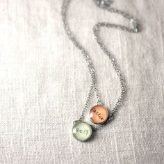 capture your child's handwriting in a charm to wear around your neck... I LOVE this!