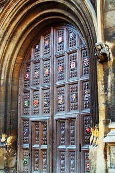 The door to the Old Bodleian Library of Oxford University, with the coat-of-arms of several of the University's colleges.
