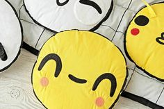 What's not to love about the Emoji Activity Baby Play Mat from Land of Nod?