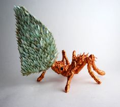 In his mixed media sculptures of animals and insects artist Sean Avery creates fur and feathers using meticulously layered fragments of broken CDs.