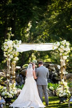 This arbor, the flowers, and the big bow on her dress. I love all of it! Photo Credit: Morby Photography #brandywinemanorhouse