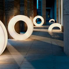 Atollo Floor Lamp - The circles mimic the rings from the ancient Mayan game called Pok-ta-Pok.