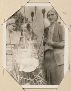 Virginia Woolf stands outdoors. Monk's House (Sussex, England), 1931 August