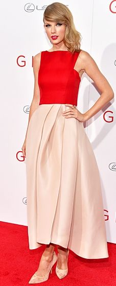 The singer-actress wore a Monique Lhuillier dress featuring a red bodice and blush skirt with Casadei heels to the premiere of The Giver.