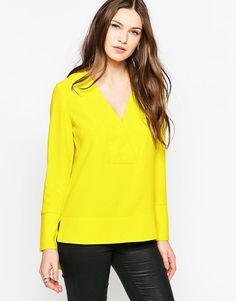 Buy it now. French Connection Arrow Crepe V Neck Tunic - Yellow. Top by French Connection, Crepe fabric, V-neckline, Curved hemline, Regular fit - true to size, Hand wash, 100% Polyester, Our model wears a UK 8/EU 36/US 4. ABOUT FRENCH CONNECTION French Connection have been creating well-designed, fashion-forward collections since 1972, delivering stylish separates, statement dresses and clean-cut tailoring with a unique, classic twist. Bridging the gap between day and evening attire, their…