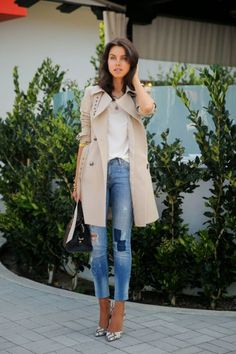 trench coat with patched jeans and blouse