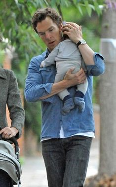Benedict Cumberbatch cradles his baby son on walk with wife Sophie Hunter | Daily Mail Online