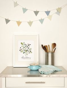 cute print, but also love the bunting with the baby clothes pins, and probably from paint swatches.  going to make one tomorrow
