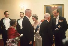 Queen Elizabeth II presses flesh at a reception prior to a State dinner at…