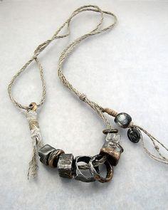 Kathy Van Kleek – Epic Cubes - steel with bronze overlays on linen cord with a Basha bead
