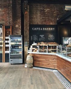 Philadelphia's renowned coffee roasting company, La Colombe, sits in a giant refurbished Fishtown warehouse that is part restaurant, part bakery and part bar. Cozy Coffee Shop, Coffee Shop Design, Coffee Shops Ideas, Coffee Coffee, Coffee Menu, Rustic Coffee Shop, Vintage Coffee Shops, Coffee Store, Coffee Poster