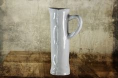 Handmade vase.  At Ami. Like us on Facebook for details.