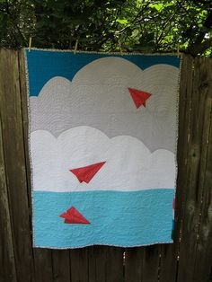 Clouds and paper airplane quilt