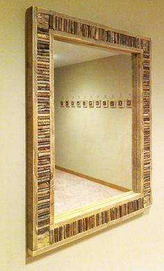 """Looking for a fun DIY project made from yard clippings and an old mirror? Here's a great way to build something new out of something old. First, we constructed a wood frame with a 2.5"""" wide channel. Then we cut, glued and tacked dozens of twigs side by side. Like traditional Adirondack furniture, we mounted birch bark in the corners as a decorative accent. Once all the pieces were set, we inserted the mirror and installed hanging hooks on the back."""