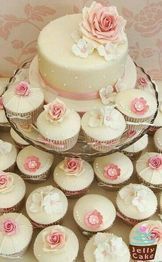 Pink Wedding Cakes - An Ivory and Dusky Pink Cupcake Tower. Top cutting cake decorated with icing pearls, a large sugar rose and sugar hydrangea petals. The cupcakes are decorated with sugar roses, glittered roses, blossom flower and hydrangea petals. Pink Wedding Cupcakes, Cupcake Tower Wedding, Pastel Cupcakes, Cupcake Towers, Flower Cupcakes, Valentine Cupcakes, Birthday Cupcakes, Cupcake Rosa, Cupcake Cakes