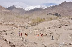Playing cricket with the nuns in their backyard. Gephel Shedrubling Nunnery.Leh, India