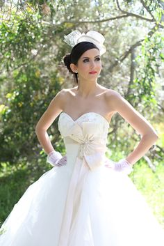 I think that everyone should have to wear a hat to the wedding!  Just too cute!  Love the dress!