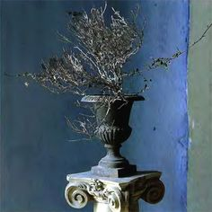 Urn on a column stuffed with dead branches.