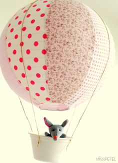 Just a lantern, some string and a basket with a Stewart little in it:-) so cute