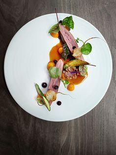 Duck with carrot, huckleberry, and kale by chef Matt Lambert. Photo by Signe Birck