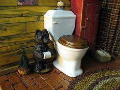 log cabin bathroom - love the toliet paper holder :)