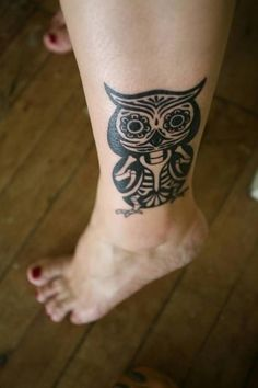 I'm not crazy about owl tattoos but I dig this one.