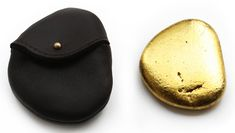 Luxury skimming stone with belt pouch, Dominic Wilcox, 2009, 24 carat gold leaf, leather, pebble. Courtesy of Dominic Wilcox