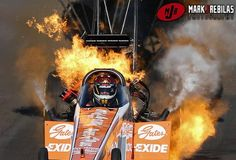 AWESOME shot of Clay Millican in E1 in NHRA race in Phoenix.  Thanks Mark J. Rebilas Photography!!  (BTW, Clay was fine - the car, not so much.)