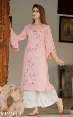 Kurta Sets Women Rayon Slub Straight Embroidered Long Kurti With Palazzos Kurta Fabric: Rayon Slub Bottomwear Fabric: Rayon Slub Fabric: Rayon Slub Sleeve Length: Three-Quarter Sleeves Set Type: Kurta With Bottomwear Bottom Type: Palazzos Pattern: Embroidered Sizes: S (Bust Size: 36 in, Shoulder Size: 14.5 in, Kurta Waist Size: 32 in, Kurta Hip Size: 38 in, Kurta Length Size: 41 in, Bottom Waist Size: 20 in, Bottom Length Size: 38 in)  XL (Bust Size: 42 in, Shoulder Size: 15.5 in, Kurta Waist Size: 38 in, Kurta Hip Size: 44 in, Kurta Length Size: 41 in, Bottom Waist Size: 23 in, Bottom Length Size: 38 in)  L (Bust Size: 40 in, Shoulder Size: 15.5 in, Kurta Waist Size: 36 in, Kurta Hip Size: 42 in, Kurta Length Size: 41 in, Bottom Waist Size: 22 in, Bottom Length Size: 38 in)  M (Bust Size: 38 in, Shoulder Size: 15 in, Kurta Waist Size: 34 in, Kurta Hip Size: 40 in, Kurta Length Size: 41 in, Bottom Waist Size: 21 in, Bottom Length Size: 38 in)  XXL (Bust Size: 44 in, Shoulder Size: 16 in, Kurta Waist Size: 40 in, Kurta Hip Size: 46 in, Kurta Length Size: 41 in, Bottom Waist Size: 24 in, Bottom Length Size: 38 in)  Country of Origin: India Sizes Available: S, M, L, XL, XXL   Catalog Rating: ★4.2 (1005)  Catalog Name: Women Rayon Slub Straight Embroidered Long Kurti With Palazzos CatalogID_2689007 C74-SC1003 Code: 294-13654914-7131