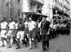 French and African members of the French Resistance march through the streets of Agen in the soutwest of France during the city's liberation from German control.