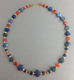 Babylonian Lapis Lazuli and Carnelian Bead Necklace An ancient Babylonian lapis lazuli and carnelian bead necklace, restrung with modern gold components and clasp. Ca. 9th -7th century BC.  Length of necklace: 22 in. (56 cm). Intact and wearable