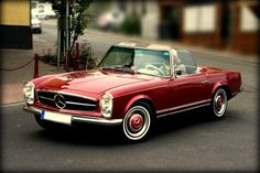 Mercedes 280 sl. I always said I would be driving one of these when I turned 50....